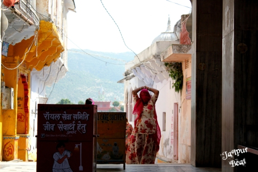 A lady walking in the colorful streets of Pushkar