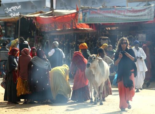 A foreigner making her way through the Pushkar fair