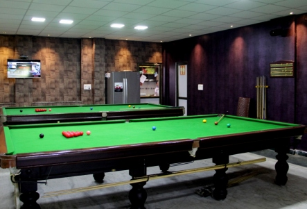Pool tables give a sporty feel to the cafe.