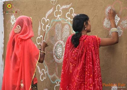 Women participating in the Mandna competition.
