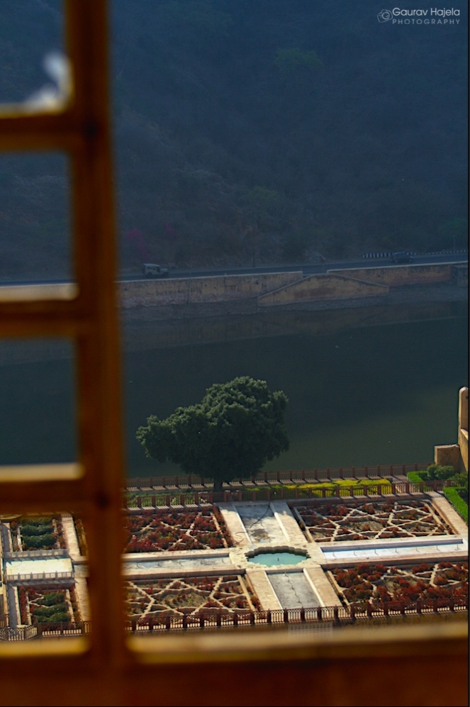 A bright view of Kesar Kyari Bagh from a window of Amer Fort