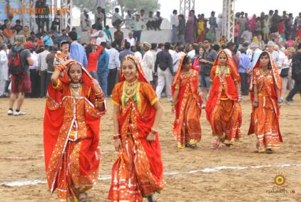 little school girls moving towards the stage for their performance