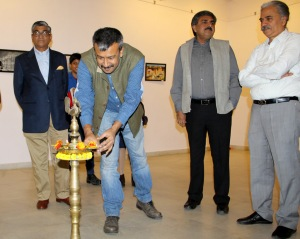 Mr. Gaurav Hajela, professional photographer and founder of Jaipur Beat lighting the inaugural lamp