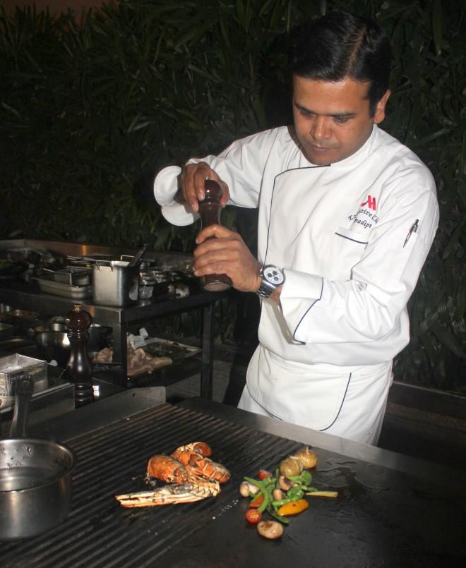 Chef Pradipt SInha preparing a dish.JPG